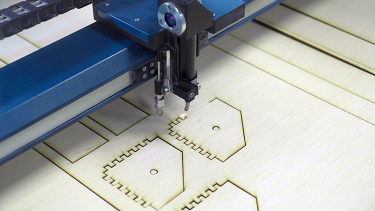 Epilog Laser machine cutting out finger joints.