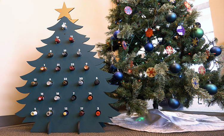 The completed laser cut wine advent tree with wine bottles.